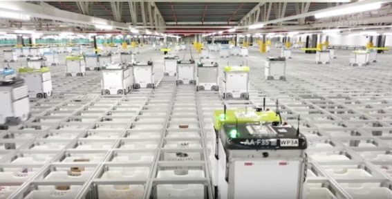 Robots pack groceries around grid system
